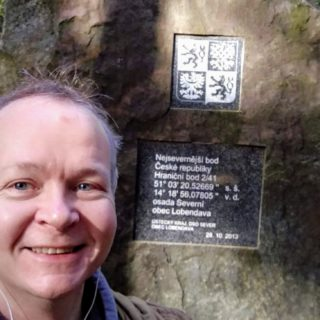 Selfie at the stone marking the northernmost point of the Czech Republic