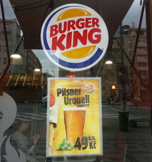 Photo of an advert of draught Pilsner Urquell at Burger King