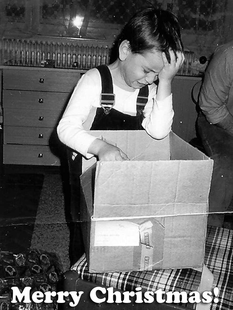 Image of boy crying after opening Christmas present