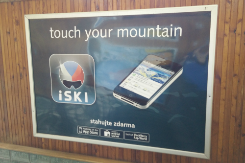 "Photo of iSki phone app billboard with slogan ""touch your mountain"""